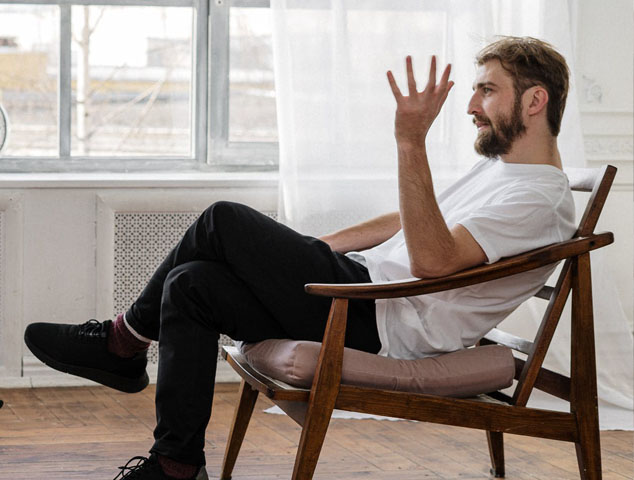 man sitting in counselling session