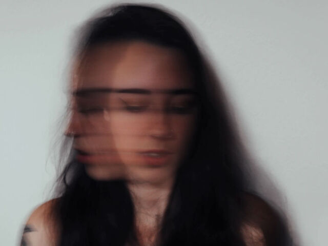 woman shaking head anxiety attack
