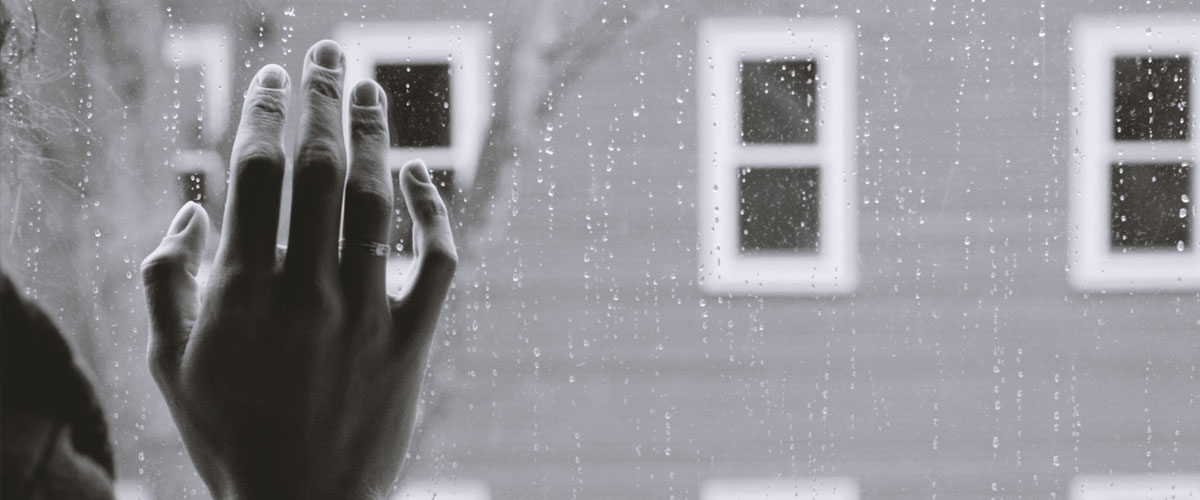 domestic-violence-woman-hand-on-window
